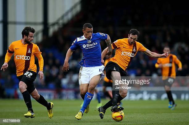 Jonson ClarkeHarris of Oldham Athletic battles with Rory McArdle of Bradford City during the Sky Bet League One match between Oldham Athletic and...