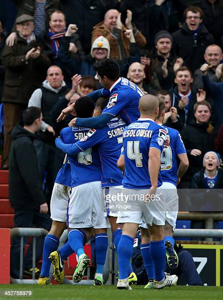 Jonson ClarkeHarris of Oldham Athletic celebrates his goal with team mates during the Sky Bet League One match between Oldham Athletic and Bradford...