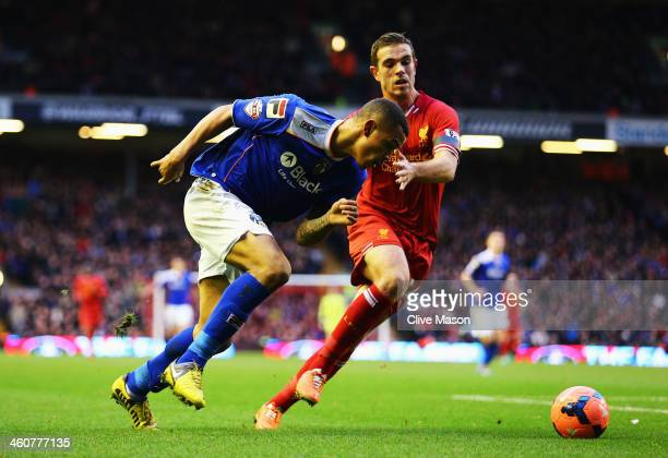 Jonson ClarkeHarris of Oldham takes on Jordan Henderson of Liverpool during the Budweiser FA Cup third round match between Liverpool and Oldham...