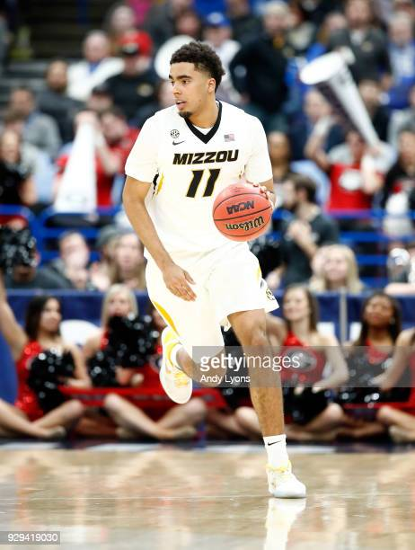 Jontay Porter of the Missouri Tigers dribbles the ball against the Georgia Bulldogs during the second round of the 2018 SEC Basketball Tournament at...