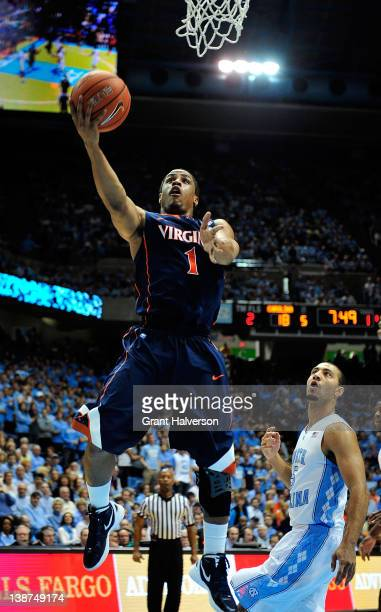 Jontel Evans of the Virginia Cavaliers drives past Kendall Marshall of the North Carolina Tar Heels during play at the Dean Smith Center on February...
