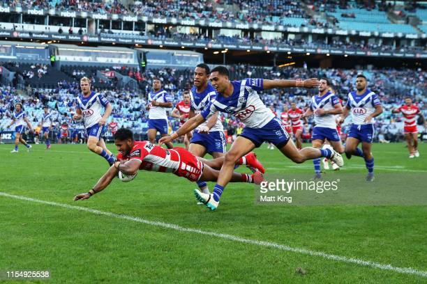 Jonus Pearson of the Dragons scores a try during the round 13 NRL match between the Canterbury Bulldogs and the St George Illawarra Dragons at ANZ...