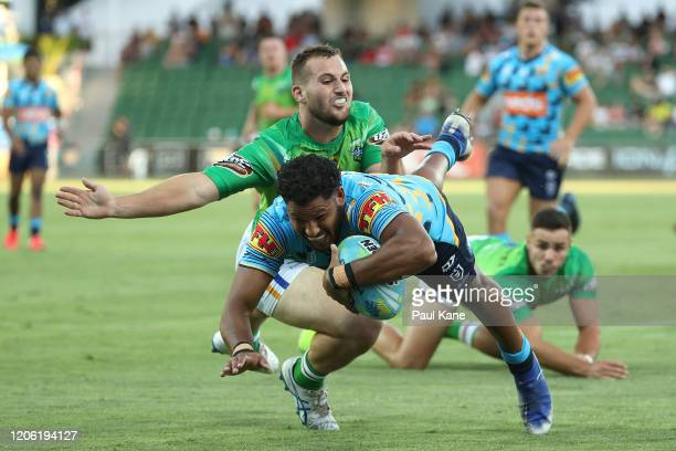 Jonus Pearson of the Titans crosses for a try during Day 1 of the 2020 NRL Nines match between The Titans and the Raiders at HBF Park on February 14,...