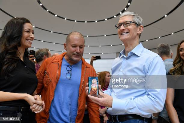 Jony Ive chief design officer for Apple Inc center and Tim Cook chief executive officer of Apple Inc view the iPhone X during an event at the Steve...