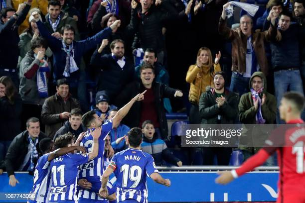 Jony of Deportivo Alaves celebrates 10 with Mubarak Wakaso of Deportivo Alaves Aleix Vidal of Sevilla FC during the La Liga Santander match between...