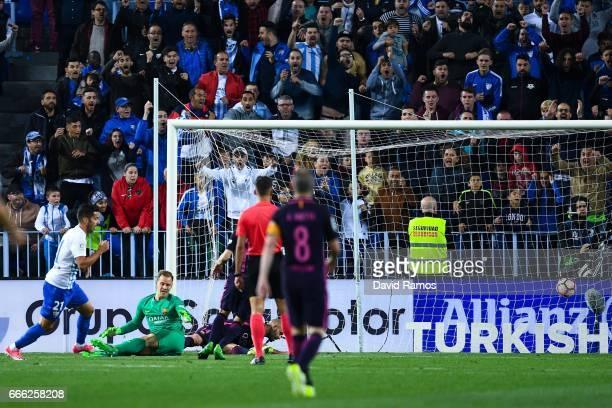 Jony Rodriguez of Malaga CF scores his team's second goal during the La Liga match between Malaga CF and FC Barcelona at La Rosaleda stadium on April...