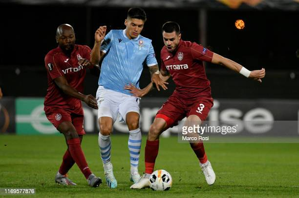 Jony Rodriguez of SS Lazio compete for the ball with Lacina Traor during the UEFA Europa League group E match between CFR Cluj and Lazio Roma at...