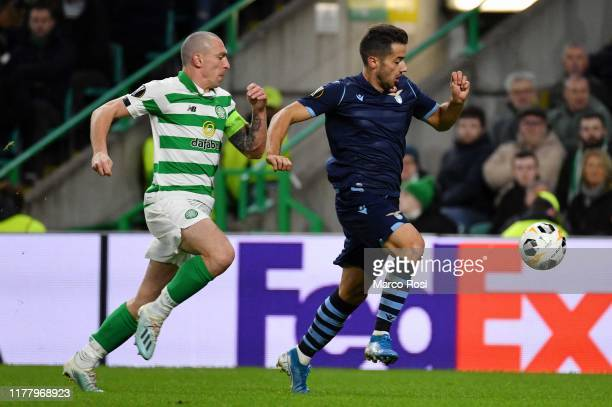Jony Rodriguez of SS Lazio competes for the ball with Scott Brown of Celtic FC during the UEFA Europa League group E match between Celtic FC and...