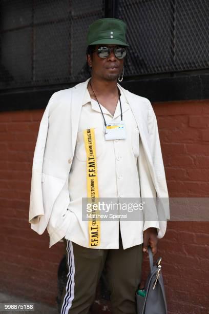 Jonzu is seen on the street during Men's New York Fashion Week wearing Jill Sanders GCDS Craig Green sneakers on July 11 2018 in New York City