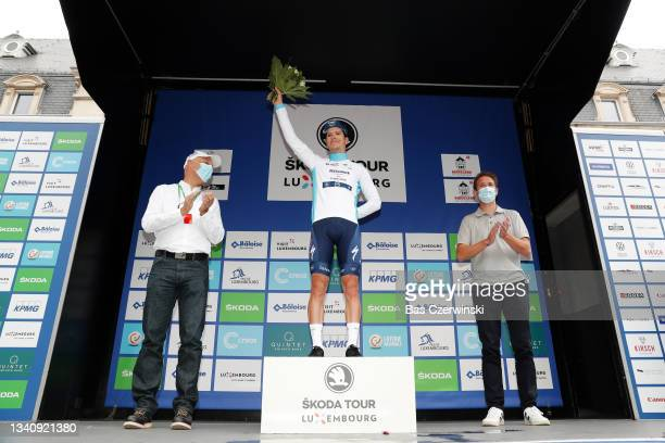 João Almeida of Portugal and Team Deceuninck - Quick-Step celebrates winning white best young rider jersey on the podium ceremony after after the...