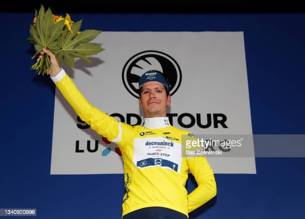João Almeida of Portugal and Team Deceuninck - Quick-Step celebrates winning the yellow leader jersey on the podium ceremony after after the 81st...