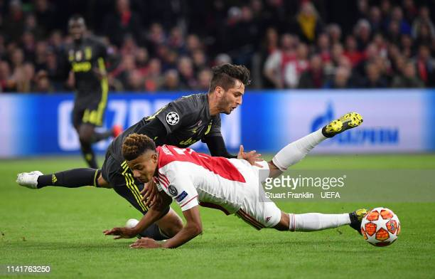 João Cancelo of Juventus challenges David Neres of Ajax during the UEFA Champions League Quarter Final first leg match between Ajax and Juventus at...