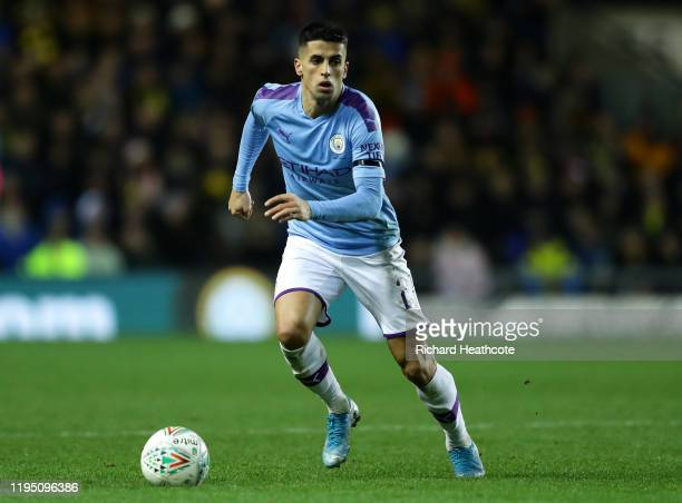 João Cancelo of Manchester City in action during the Carabao Cup Quarter Final match between Oxford United and Manchester City at Kassam Stadium on...