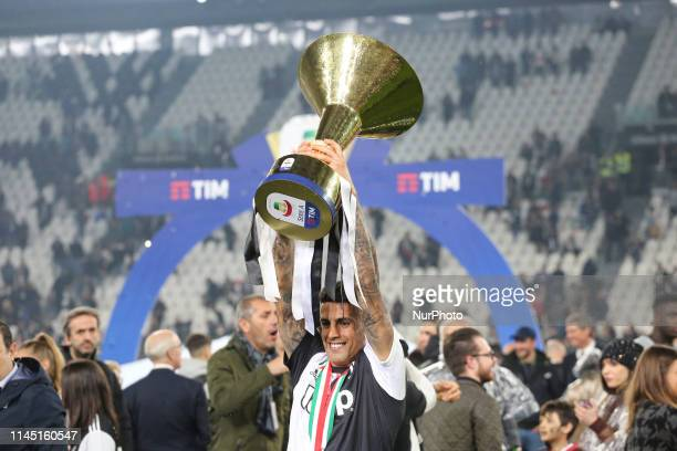 Joo Cancelo with the trophy of Scudetto during the victory ceremony following the Italian Serie A last football match of the season Juventus versus...