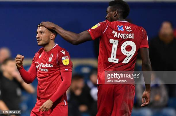 João Carvalho of Nottingham Forest celebrates with Sammy Ameobi after scoring his team's third goal during the Sky Bet Championship match between...