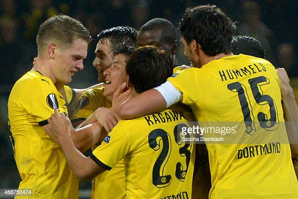 Joo Ho Park of Dortmund is hugged by team mates after scoring his team's second goal during the UEFA Europa League Group C match between Borussia...