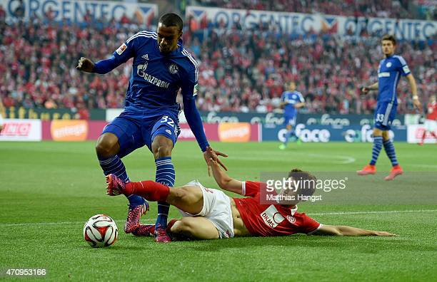 Joo Ho Park of Mainz is challenged by Joel Matip of Schalke during the Bundesliga match between 1 FSV Mainz 05 and FC Schalke 04 at Coface Arena on...