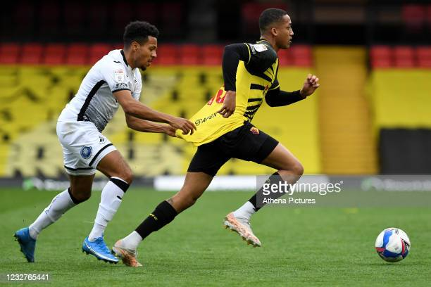 João Pedro of Watford under pressure from Korey Smith of Swansea City during the Sky Bet Championship match between Watford and Swansea City at...