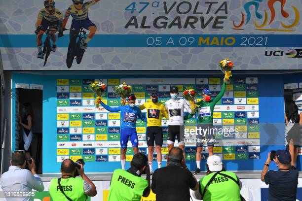 João Rodrigues of Portugal and Team W52/Fc Porto Blue Mountain Jersey, Ethan Hayter of United Kingdom and Team INEOS Grenadiers Yellow Leader Jersey,...