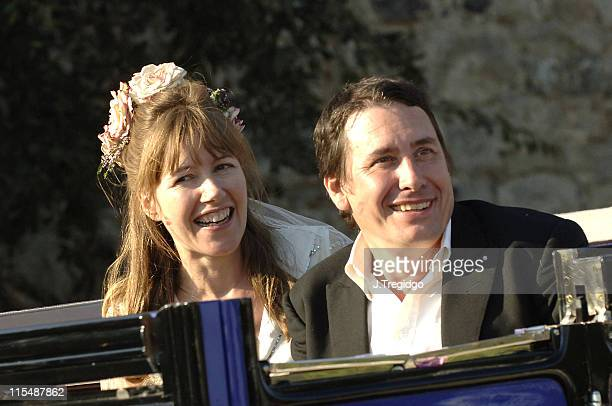 Jools Holland and Cristabel McEwen leaving during Jools Holland and Christabel McEwan's Wedding at St James's Church in Cooling Kent Great Britain
