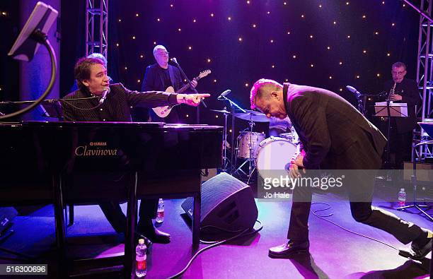 Jools Holland and Suggs perform on stage at 'An Evening With Suggs And Friends' in aid of pancreatic cancer at Emirates Stadium on March 17 2016 in...