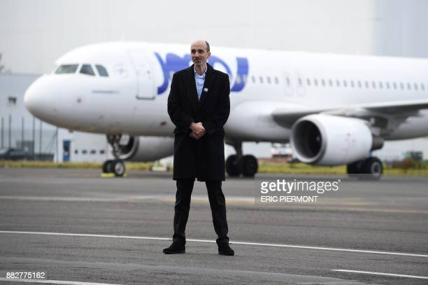 Joon Chief Executive JeanMichel Mathieu poses in front of an Airbus A320 wearing the colors of Joon the new airline subsidiary of Air France on...