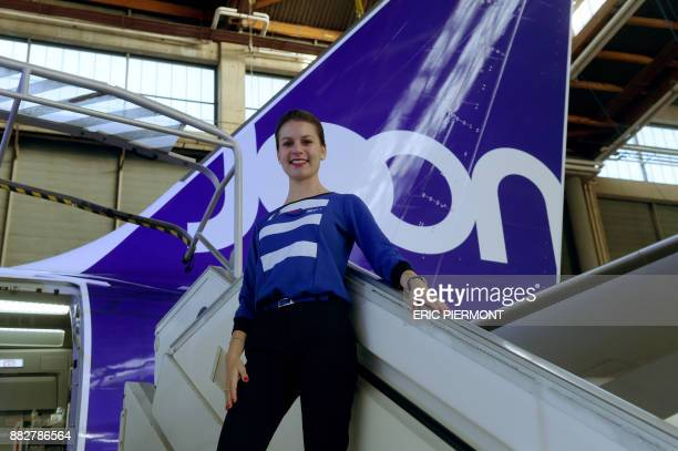 A Joon stewardess poses in front of an Airbus A320 of the new airline subsidiary of Air France on November 30 2017 at Air France Industries...
