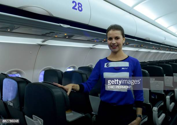 A Joon stewardess poses in the cabin of an Airbus A320 of the new airline subsidiary of Air France on November 30 2017 at Air France Industries...