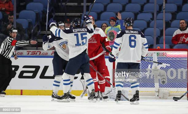 Joona Koppanen of Finland celebrates after scoring on Denmark in the first period during the IIHF World Junior Championship at KeyBank Center on...