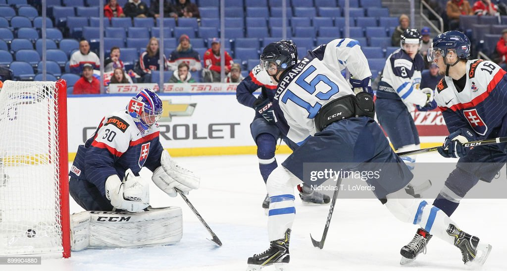 Joona Koppanen #15 of Finland tips a goal past Roman Durny #30 of Slovakia during the second period of play in the IIHF World Junior Championships at the KeyBank Center on December 30, 2017 in Buffalo, New York.
