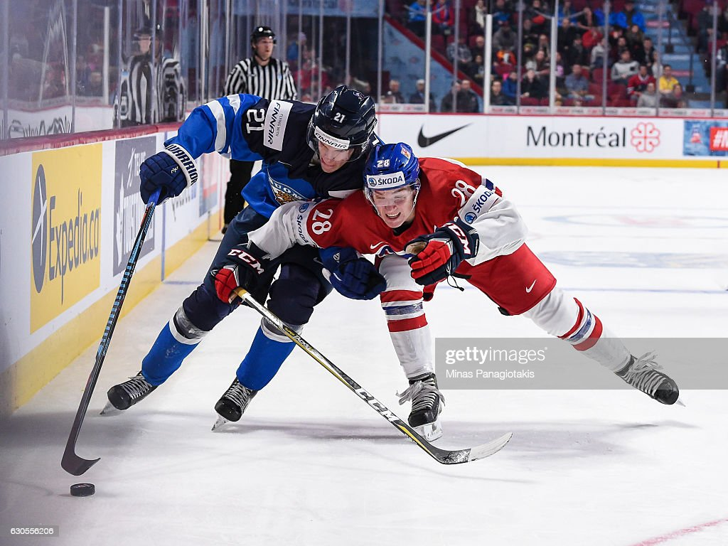 Joona Luoto #21 of Team Finland and Petr Kalina #28 of Team Czech Republic skate after the puck during the IIHF World Junior Championship preliminary round game at the Bell Centre on December 26, 2016 in Montreal, Quebec, Canada.