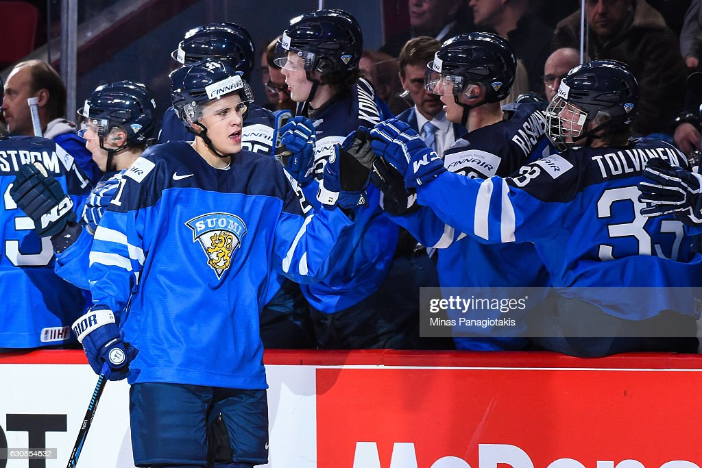 Joona Luoto #21 of Team Finland celebrates a first period goal with teammates on the bench during the IIHF World Junior Championship preliminary round game against Team Czech Republic at the Bell Centre on December 26, 2016 in Montreal, Quebec, Canada.