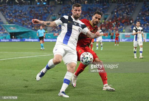 Joona Toivio of Finland battles for possession with Nacer Chadli of Belgium during the UEFA Euro 2020 Championship Group B match between Finland and...