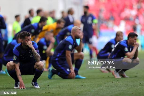 Joona Toivio of Finland looks dejected as Christian Eriksen of Denmark receives medical treatment during the UEFA Euro 2020 Championship Group B...