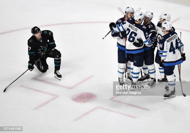 Joonas Donakoi of the San Jose Sharks looks up at the scoreboard as the Winnipeg Jets celebrate their victory at SAP Center on December 20 2018 in...