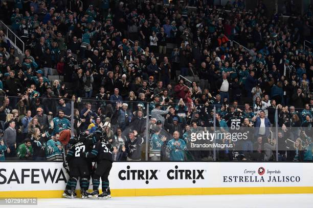 Joonas Donskoi and Logan Couture of the San Jose Sharks celebrate a goal against the Dallas Stars at SAP Center on December 13 2018 in San Jose...