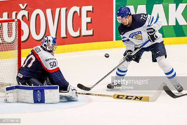 Joonas Donskoi of Finland tries to score against Jan Laco goalkeeper of Slovakia during the IIHF World Championship group B match between Finland and...