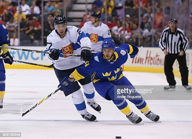 Joonas Donskoi of Team Finland and Niklas Hjalmarsson of Team Sweden battle for a loose puck during the World Cup of Hockey 2016 at Air Canada Centre...