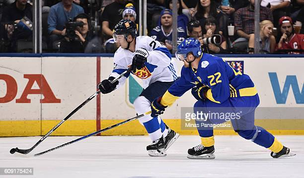 Joonas Donskoi of Team Finland stickhandles the puck with Daniel Sedin of Team Sweden chasing during the World Cup of Hockey 2016 at Air Canada...