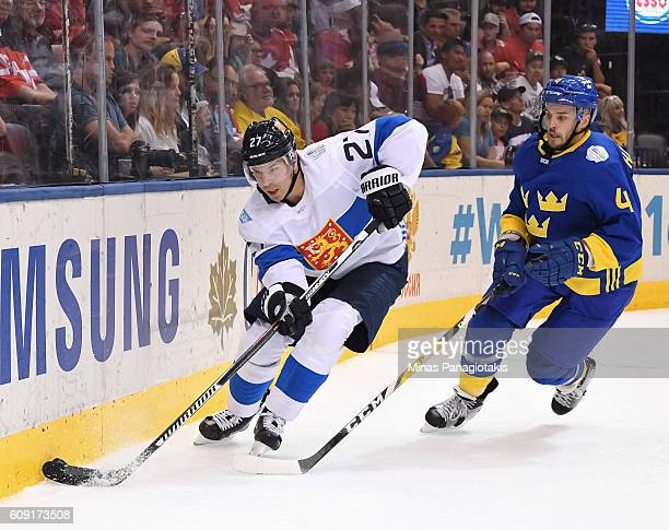 Joonas Donskoi of Team Finland stickhandles the puck with Niklas Hjalmarsson of Team Sweden chasing during the World Cup of Hockey 2016 at Air Canada...
