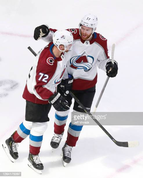 Joonas Donskoi of the Colorado Avalanche is congratulated by teammate JT Compher after he scored a goal in the first period against the Dallas Stars...