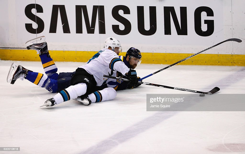 Joonas Donskoi #27 of the San Jose Sharks and Patrik Berglund #21 of the St. Louis Blues battle for the puck during the first period in Game Two of the Western Conference Final during the 2016 NHL Stanley Cup Playoffs at Scottrade Center on May 17, 2016 in St Louis, Missouri.