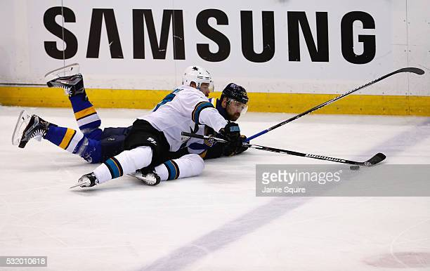Joonas Donskoi of the San Jose Sharks and Patrik Berglund of the St Louis Blues battle for the puck during the first period in Game Two of the...