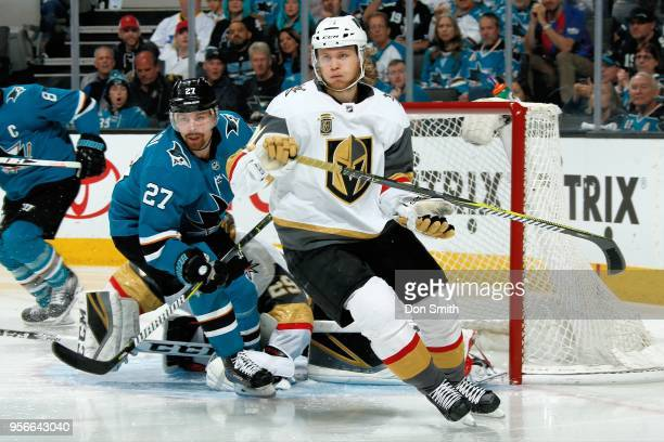 Joonas Donskoi of the San Jose Sharks and William Karlsson of the Vegas Golden Knights look in Game Six of the Western Conference Second Round during...