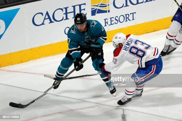 Joonas Donskoi of the San Jose Sharks battles against Ales Hemsky of the Montreal Canadiens at SAP Center on October 17 2017 in San Jose California