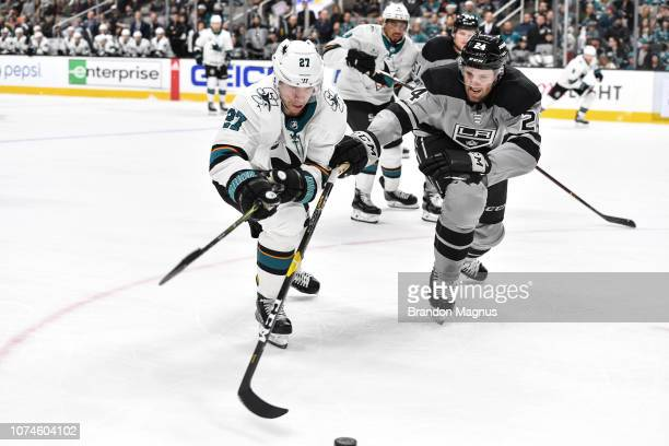 Joonas Donskoi of the San Jose Sharks battles for the puck against Derek Forbort of the Los Angeles Kings at SAP Center on December 22 2018 in San...