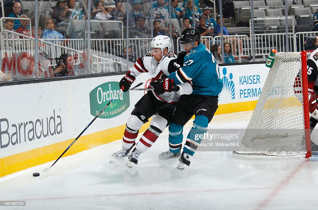 Joonas Donskoi #27 of the San Jose Sharks battles for the puck against Klas Dahlbeck #34 of the Arizona Coyotes at SAP Center on September 25, 2015 in San Jose, California.