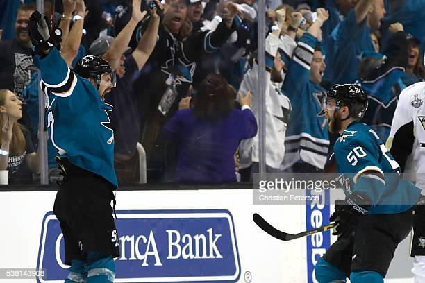 Joonas Donskoi of the San Jose Sharks celebrates his game winning goal with Chris Tierney against the Pittsburgh Penguins during overtime in Game...