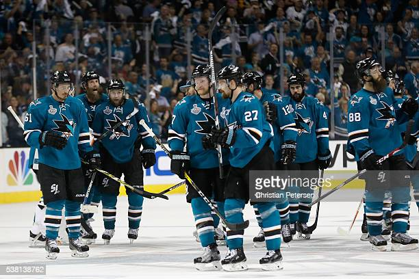 Joonas Donskoi of the San Jose Sharks celebrates with his teammates after scoring the game winning goal in overtime to defeat the Pittsburgh Penguins...