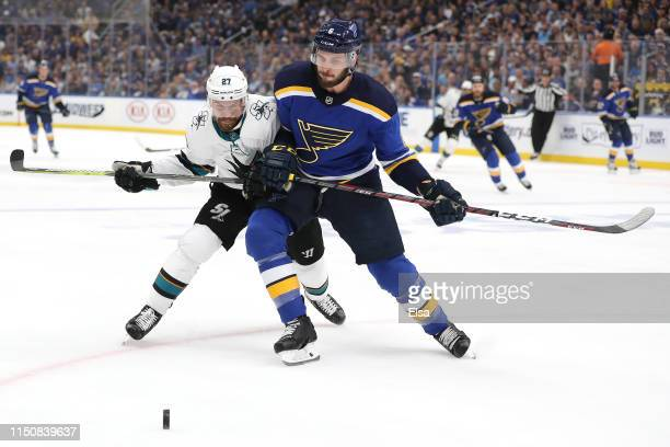 Joonas Donskoi of the San Jose Sharks collides with Joel Edmundson of the St Louis Blues during the first period in Game Six of the Western...